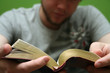 young man reading small bible - 2404155