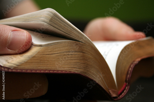 young man reading small bible - 2404157