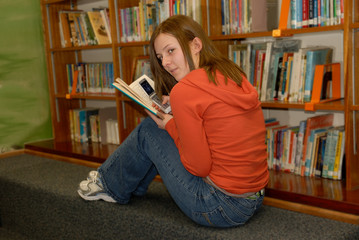 teenager in library 2 with cell phone
