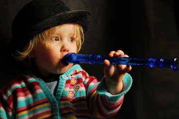 toddler with flute
