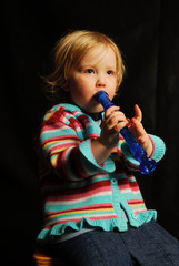 toddler with blue flute