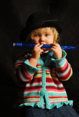 girl playing blue flute