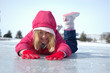 young girl prone on ice