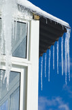 melting icicles against sky background poster