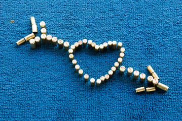 love heart; bullets