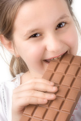 little girl with a block of chocolate
