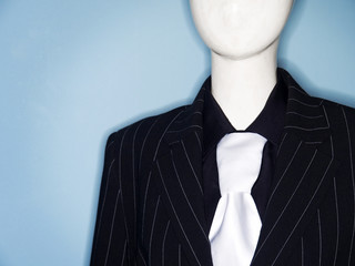 faceless dummy model dressed in business suit and