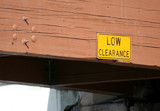 low clearance sign and bridge poster