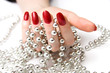woman hand and silver beads