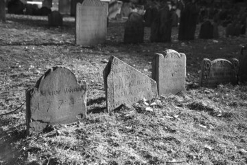 dramatically lit ancient grave stones