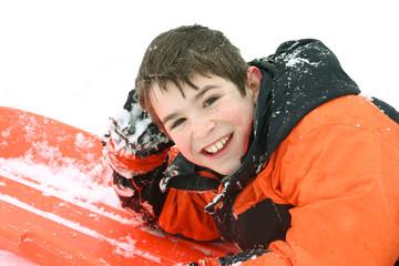 boy outdoors sledding