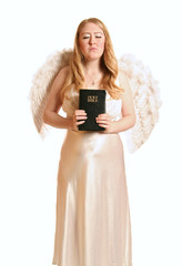 goddess angel holding bible with closed eye