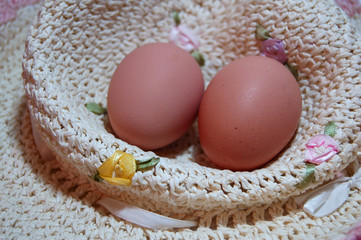 two eggs in straw hat, close-up