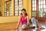healthy young woman in gym outfit sitting on the f poster