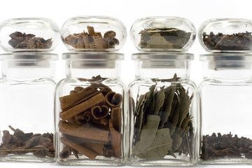 spices in bottles: anise, cinnamon, bayleaf, clove