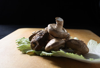 fresh shiitake mushrooms on a cabbage leaf