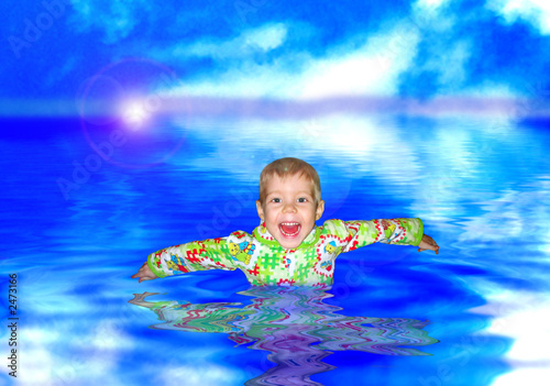 the boy bathes in water