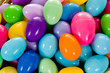 close - up of a basket full of multicolored easter eggs