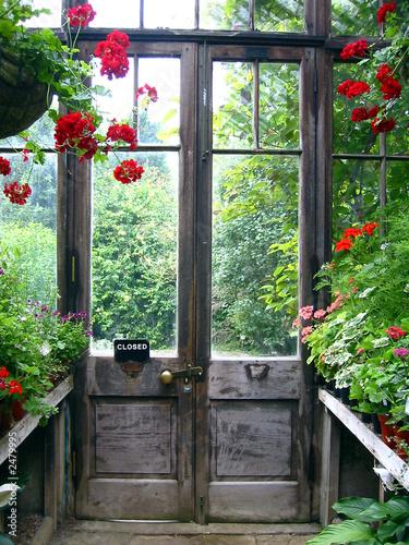 closed door in a secret garden - 2479995