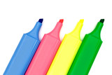 four multicolored markers on white paper poster