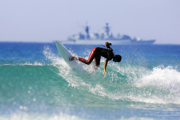 a surfer executing a backhand re entry