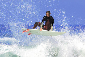 a surfer executing an ariel maneuver