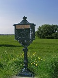 ancient postbox in the countryside poster
