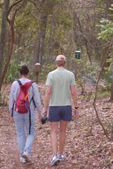 two women walking in woods