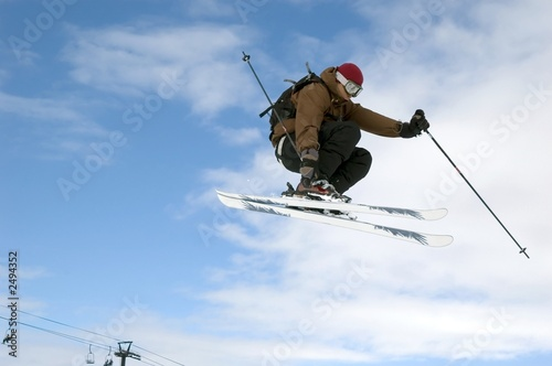 skier jumping high in the air