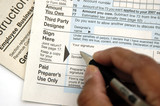 signing a tax return poster