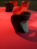 many plastic design couches on magenta red carpet - 2497902