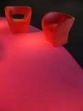 plastic design couches on magenta carpet poster