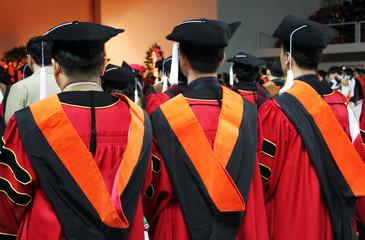 three asian university graduates
