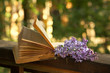 book of poetry and  lilac branch