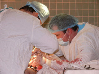 surgical team during operation: working on open wo