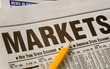 newspaper with business market results