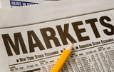 newspaper with business market results poster