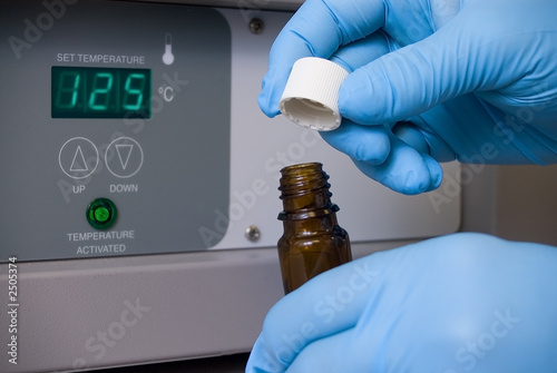 lab worker with a vial