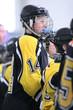 boy ice hockey bench