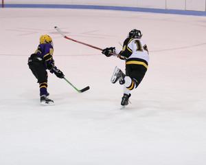 boy ice hockey slap shot