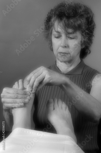 senior reflexologist soft focus
