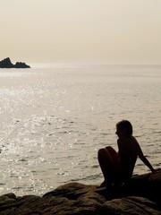 beauty women silhouette  against seaside sunset