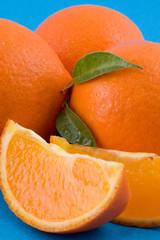 oranges over blue background