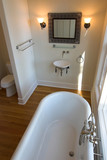 elegant bathroom with tub and sink poster