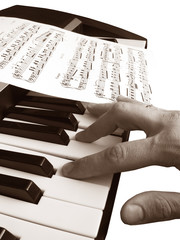 piano music with hand isolated sepia