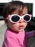 pretty baby girl with pink sun glasses