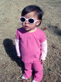pretty baby girl with pink glasses