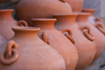 row of red clay pottery
