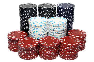 lots of poker chip stacks, isolated on a white bac