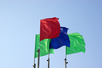 four colour flags waving  and sky